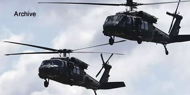 US occupation helicopters transport shoulder-fired missiles and shells to its base in Hasaka countryside