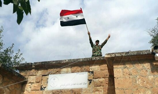 Syrian Army hoists national flag on public institutions in Ayn al-Arab